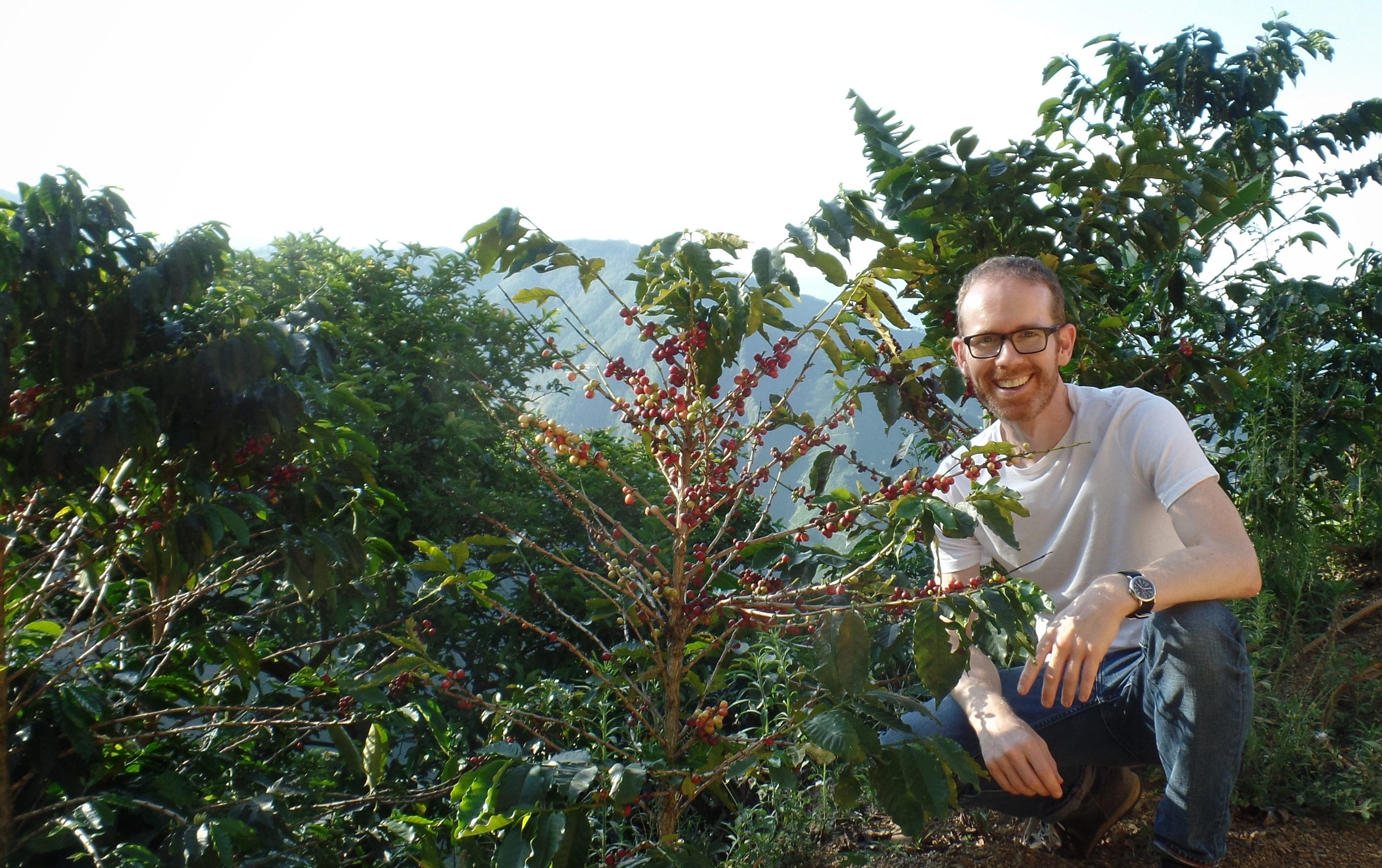 Jason with a coffee plant in Colombia