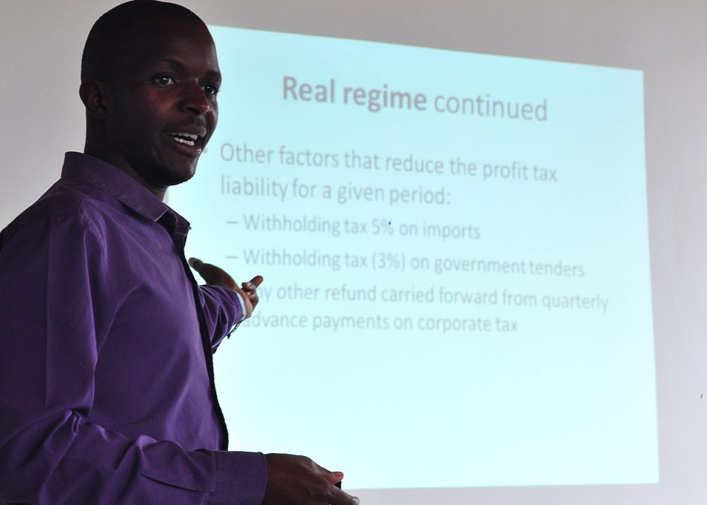 Francois Xavier Nshimiyimana, a business development associate and taxation expert gives a training to Rwanda entrepreneurs at AEC's offices in Kigali.