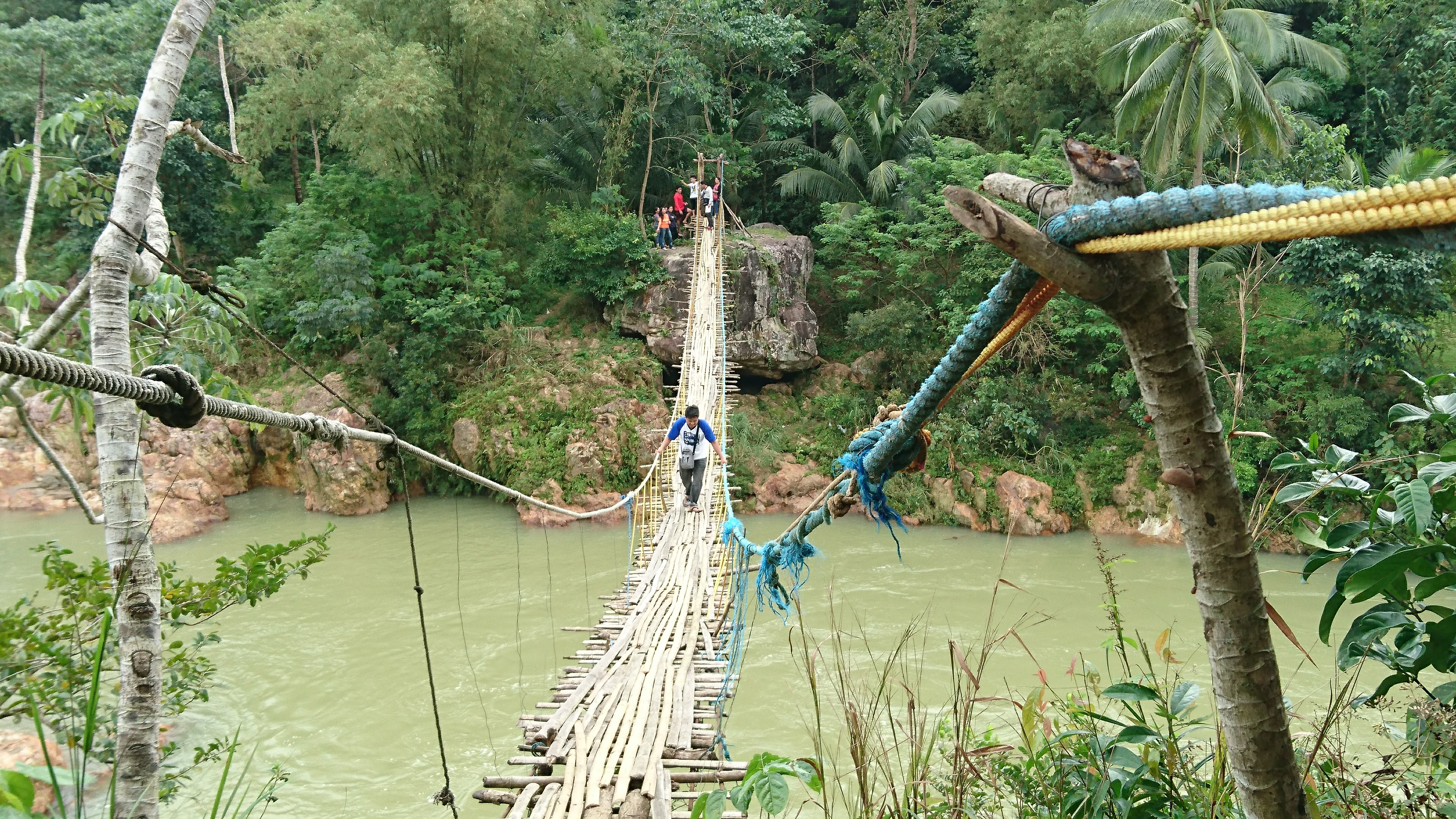 A rope bridge over a river near AIDFI.