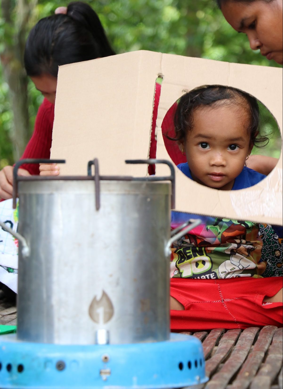 A child plays near the new, safe cookstove.
