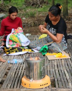 Local women with the ACE cookstove.