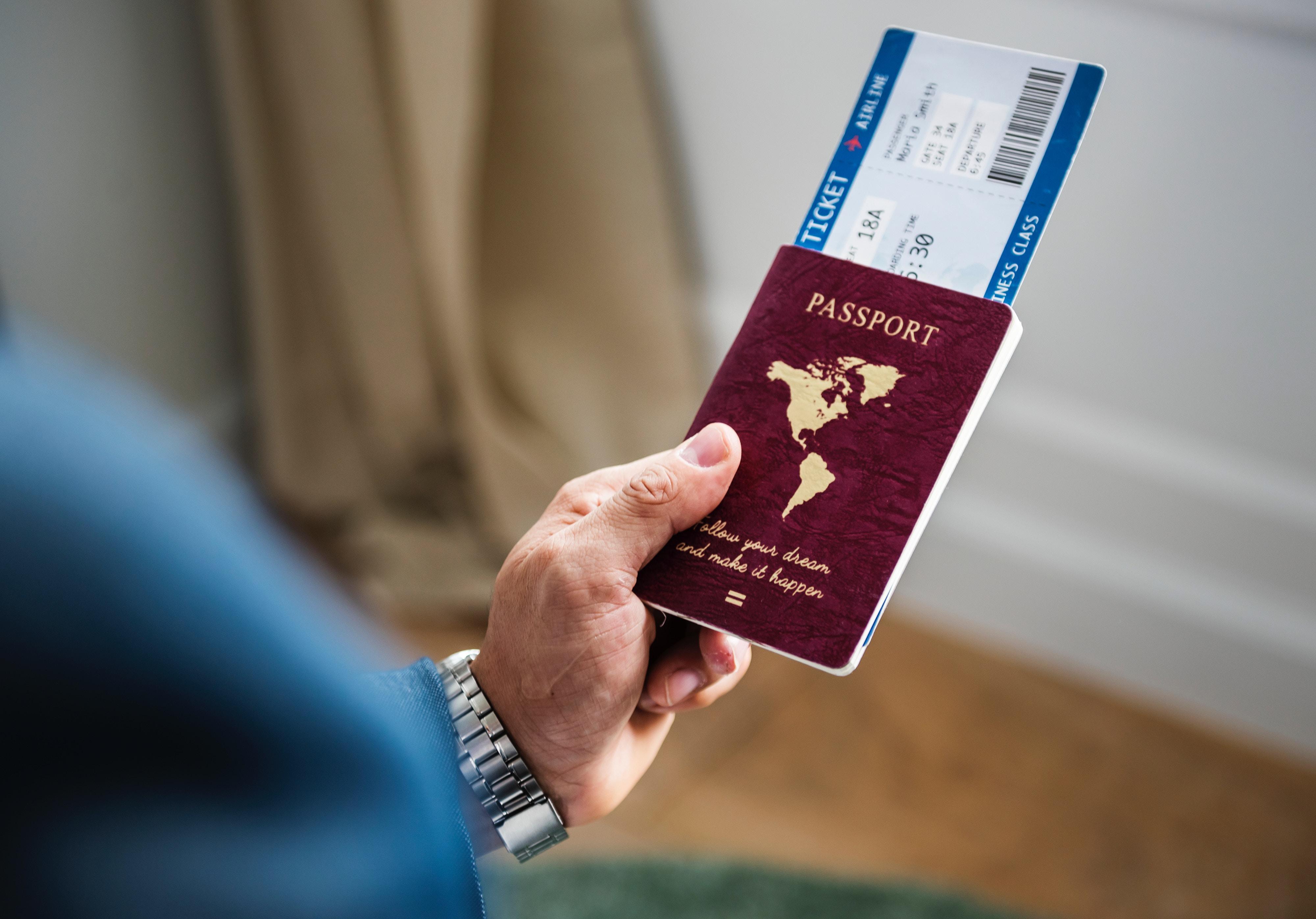 Man holding Passport - MovingWorlds Travel Checklist