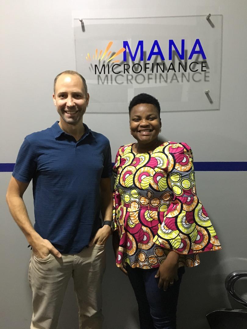 Darren working with Mana Microfinance Team