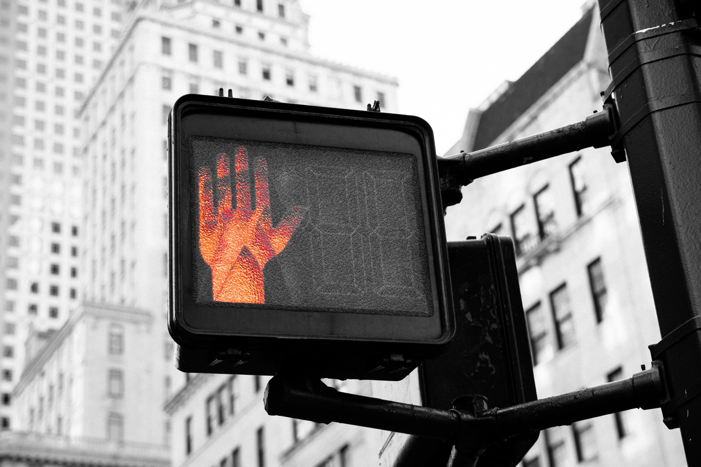 Crosswalk signal with stop hand