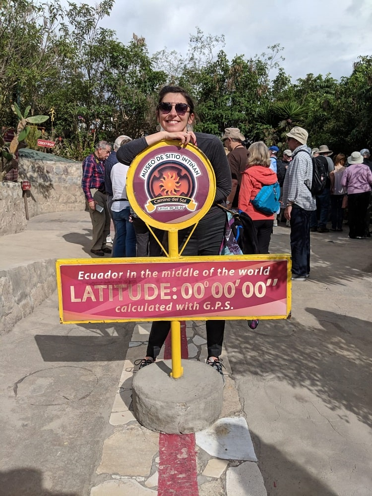 Andreia visiting the middle of the world in Ecuador