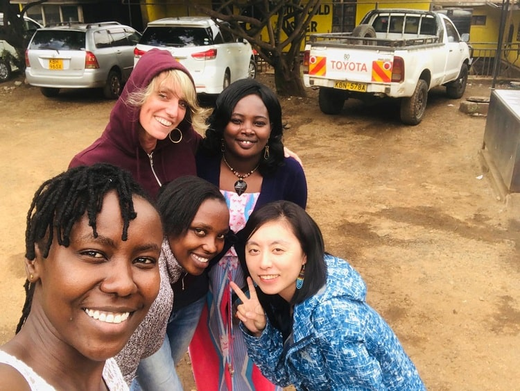 Volunteer Catherine with Flone Initiative founder and colleagues
